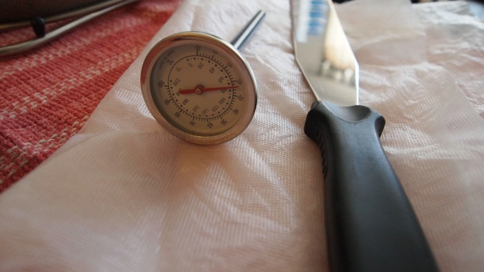 A good thermometer, a cake spatula as a curd knife, and cheesecloth
