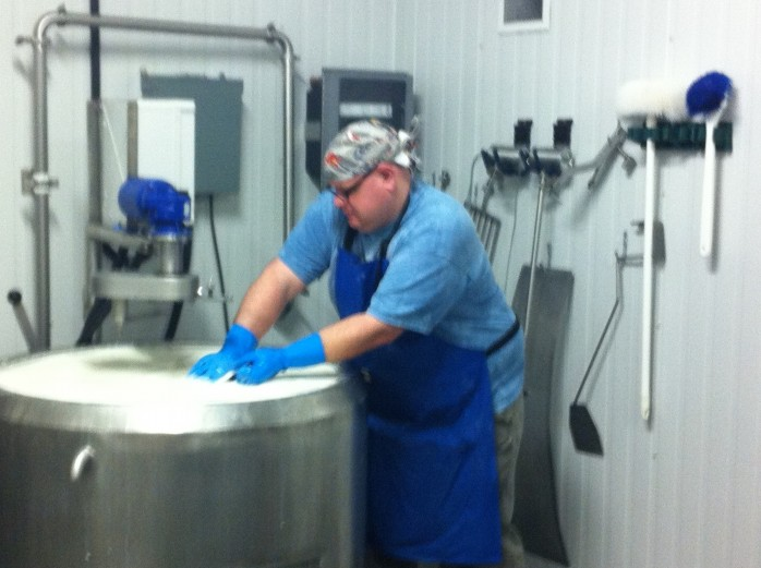 This time I got to incorporate the rennet into the milk.  I love my new blue gloves.