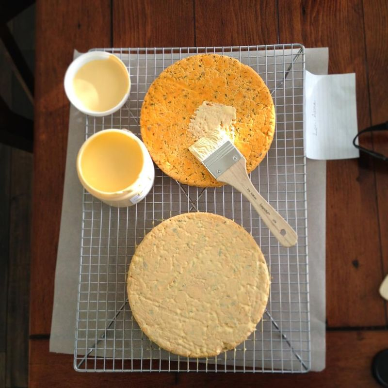 Stephanie's Cheddar being brushed with cream wax.