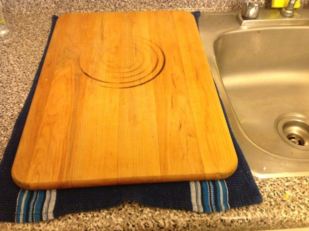 I set up next to the sink so it is easier to drain the vat later.  I put the first towel down then the board.