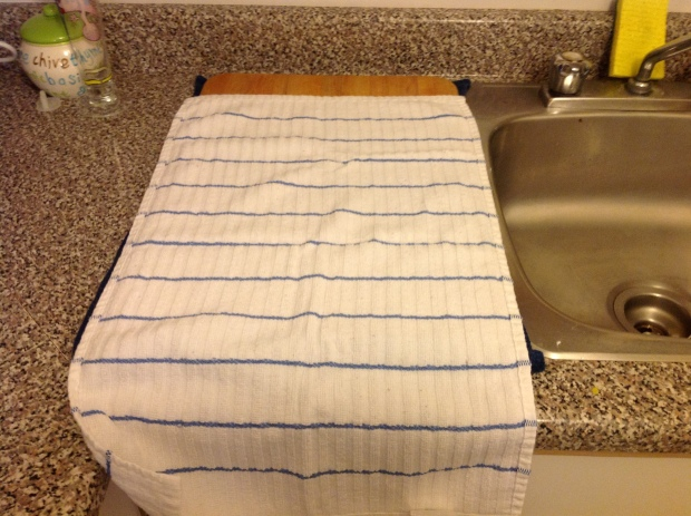 Next I place the second towel on the board.  This acts as another way to soak up and liquid and helps to keep the roaster stable.