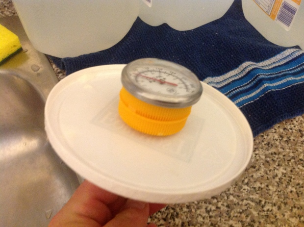 All you have to do is pierce two milk jug caps and then a yogurt lid with your theremometer.